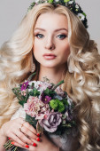 Portrait of a beautiful young blonde woman with long curly hair and eyes — Stock Photo