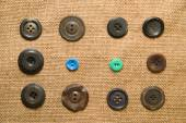 A lot of old buttons  on the old cloth — ストック写真