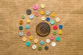 Many  vintage  buttons  on the old cloth — Stock Photo