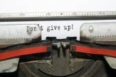"""Sheet of paper with the inscription """" Don't give up!"""" — Stock Photo"""