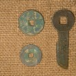 Ancient Chinese bronze coins on old cloth — Stock Photo #71498329
