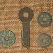 Ancient Chinese bronze coins on old cloth — Stock Photo #71498337
