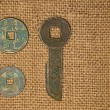 Ancient Chinese bronze coins on old cloth — Stock Photo #71513543