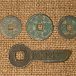 Ancient Chinese bronze coins on old cloth — Stock Photo #71513547