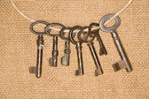 A lot vintage keys from the locks on old cloth — Stock Photo