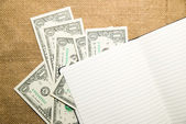 Opened notebook and money on the old tissue — ストック写真