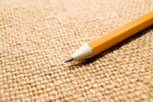 Wooden pencil drawing on an old cloth — Stock Photo