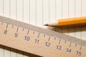 Notepads, pencil and wooden ruler on a white background — Stock Photo