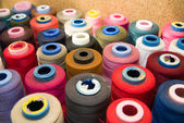 Many reels of  threads standing on the table — Stock Photo