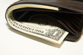 Old wallet with banknotes of US dollars inside — Stock Photo