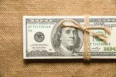 Jeden pakiet dolarów na stare tkaniny — Zdjęcie stockowe
