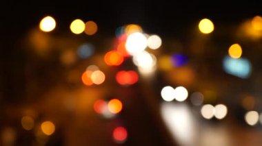 Defocused receding city traffic at night in Mumbai India near (V.T.) CST Station building at evening. — Stock Video