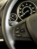 Car interior. Dashboard and controls on steering wheel — Stock Photo