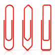 Paper clips isolated over white background, Three basic shapes. Red — Stock Photo #70640021
