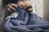 Girl in the white sweater knit blue thread — Stock Photo