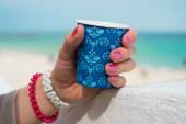 Blue cup of coffee in a female hand — Stock Photo