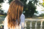 Young slender red-haired woman walking in the park sunny summer — Stock Photo