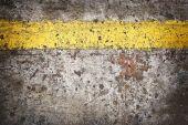 Grunge floor with yellow line — Stock Photo