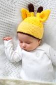 Baby sleeping in giraffe hat — Stock Photo