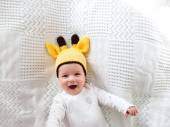 Baby  in giraffe hat — Stock Photo
