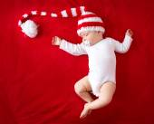 Baby in red white knitted hat — Stock Photo