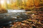 Waterfall with a shining sun — Stock Photo