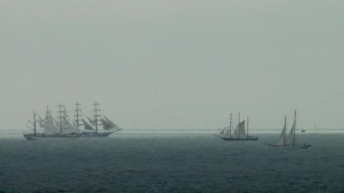 4 sailing ship maneuvering in a stormy sea during — Stock Video