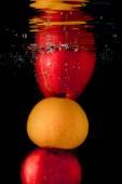 Splashing fruit on water. — Stock Photo