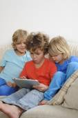Brother play a game on a tablet — Stock Photo
