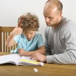 Dad helping with homework — Stock Photo #68275299