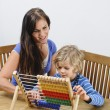 Mother teaches her son to count — Stock Photo #68279209
