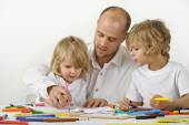 Father teaching children — Stock Photo