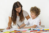 Child shows drawing to mother — Stock Photo