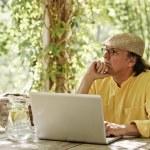 Pensive senior man with laptop — Stock Photo #68451231