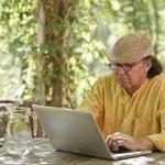 Senior man outdoors with laptop — Stock Photo #68454181