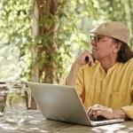 Senior man outdoors with laptop — Stock Photo #68454431