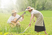 Music and work in vegetable garden — Stock Photo