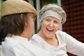 Senior woman laughs — Stock Photo