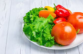 Mixed fresh vegetables on the white plate — Foto Stock
