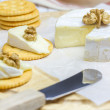 Soft brie cheese with crackers and nuts — Stock Photo #71884499