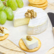 Soft brie cheese with crackers and nuts closeup — Stock Photo #71960457