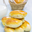 Russian pastries (pirogi) and milk on wooden table — Stock Photo #72402721