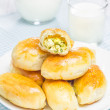 Russian pastries (pirogi) filled with eggs and green onion, closeup — Stock Photo #73309081