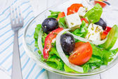Greek salad in a glass bowl closeup — Stock Photo