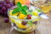 Fresh healthy fruit salad in a bowl — Stock Photo