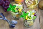 Fresh healthy fruit salad in a glass — Stock Photo