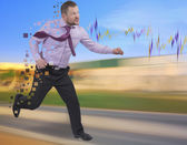 Running businessman in a hurry on blurred background — Stock Photo