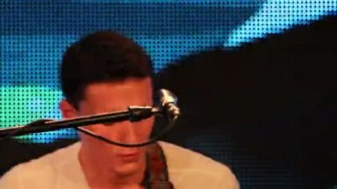 Rock concert - rock band on stage: singer sings his part (close-up, front view) — Stock Video