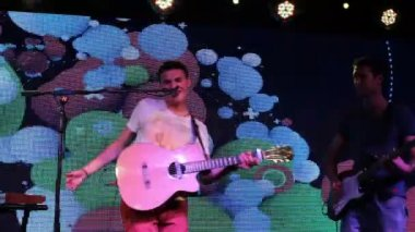 Rock concert - guitarist and singer rock on the stage — Stock Video