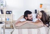 Happy couple on bed — Stock Photo